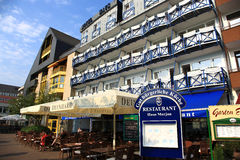 City of  Koblenz. Bar and restaurant or hotel nearby Rhine rive in the city of Koblenz.germany Royalty Free Stock Photography