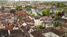 The city of Konstanz. The view from the heights of the old town of Konstanz. The video shows the old houses, narrow streets and a. Lot of red roof tiles. HD stock video footage