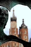 City of Krakow. Sculpture and St Mary's church on main market square in Krakow in Poland Stock Photos