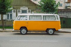 Old volkswagen bus at street. Urban city photo 2016. City Kraslava, Latvia. Old volkswagen bus at street. Urban city photo. Street, way and green grass. 21.05 royalty free stock photography