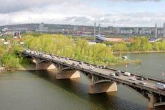 City Krasnoyarsk. View on the river Yenisei and Kommunalnyy bridge. KRASNOYARSK, RUSSIA - May 22.2008: Kommunalnyy bridge across the river Yenisei in Siberian Stock Image