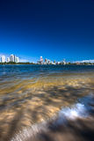 City Lake Falls. View of the city from a small waterfall Royalty Free Stock Photo