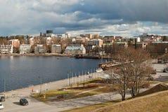 City by lake. Stock Photos