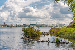 City lake view with rain clouds. Stock Photo