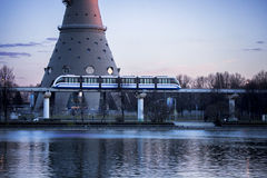 City land transport. Monorail rides near Ostankino pond and Ostankino television center. Moscow, Russia Stock Photos