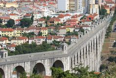 City landscape. With several buildings houses and an aqueduct Stock Photos