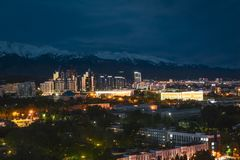City landscape on a background of snow-capped Tian Shan mountains in Almaty Kazakhstan. City landscape on a background of snow-capped Tian Shan mountains. The stock images
