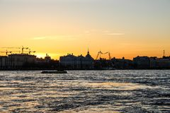 City landscape beautiful sunset on the river. City landscape beautiful sunset on the Neva river Royalty Free Stock Photography