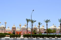 City landscape with beautiful temples, mosques, buildings with round domes in the Arab Muslim Muslim Egyptian street against the b stock image