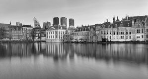 City Landscape, black-and-white panorama - view on pond Hofvijver and complex of buildings Binnenhof in from the city centre of Th. E Hague, The Netherlands royalty free stock photo