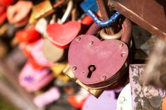 Colorful heart  locks. City landscape. Metal bridge with a lot of colorful locks. Wedding Traditions Royalty Free Stock Photography