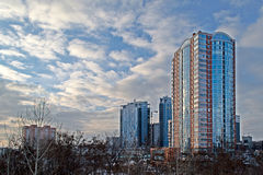 City landscape with modern buildings and blue sky with white clouds Stock Images
