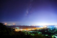 City landscape at nigh with Milky Way galaxy, Long exposure phot Stock Photography