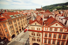 City landscape with red tiles on roofs and historical street of old Prague Royalty Free Stock Photography
