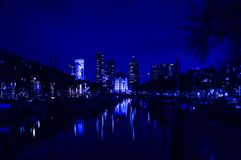 City landscape with river at night time. City landscape with river water reflection of lights at night time Stock Photography