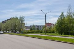 City landscape with a roadway and residential buildings. SHARYPOVO, RF - May 28, 2017: The town Sharypovo is located in the Krasnoyarsk Territory of Russia Stock Photos