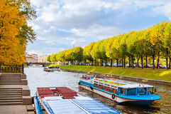 City landscape of Saint Petersburg, Russia with touristic pleasure boats on Moika river Stock Image