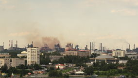 City landscape with smoking metallurgical chimneys. stock video