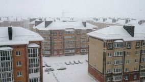 Snow over multi storey houses stock video footage