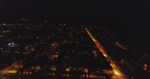 An amazing aerial view of Kohtla-Jarve City at night, Estonia. City landscape. Streets with cars at night. Night life stock footage