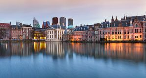 City Landscape, sunset panorama - view on pond Hofvijver and complex of buildings Binnenhof in from the city centre of The Hague. The Netherlands stock images