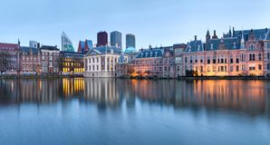 City Landscape, sunset panorama - view on pond Hofvijver and complex of buildings Binnenhof in from the city centre of The Hague. The Netherlands royalty free stock photos