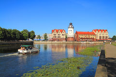 The city landscape, the tourist boat floats down the river Pregolya to the Fish village in Kaliningrad Royalty Free Stock Photo