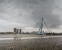 City Landscape - view on Erasmus Bridge on rainy cloudy day, city of Rotterdam. The Netherlands Stock Image