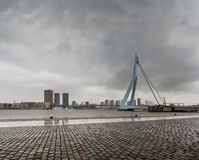 City Landscape - view on Erasmus Bridge on rainy cloudy day, city of Rotterdam. The Netherlands Stock Photos