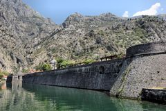 Walls and fortress of St. Ivan John, the ancient city of Kotor, Montenegro, Europe. City landscape - walls and fortress of St. Ivan John, which are included in royalty free stock photography