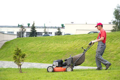 City landscaper cutting grass. With lawn mower Stock Image