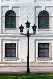 City lantern on the background wall of the palace. Riga Stock Photos