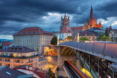 City of Lausanne. Cityscape image of downtown Lausanne, Switzerland during twilight blue hour royalty free stock photography