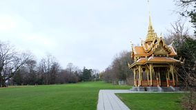 A royal pavilion in Lausanne. The City of Lausanne has the privilege of being the home of a royal Thai pavilion in Denantou Park, one of its loveliest green stock image