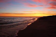Beautiful sunrise on the shore of the Baltic Sea. City of Leba, Pomorskie province, Poland. Beautiful sunrise on the shore of the Baltic Sea Stock Images