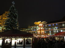 City life bustling at Christmas market by night Stock Photo