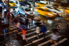 New York City at Night Cross Walk With Time Lapse Motion Blur Stock Images