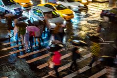 New York City at Night Cross Walk With Time Lapse Motion Blur Stock Image