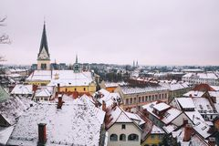 City Life of Ljubljana at winter, Slovenia, Europe. Atmospheric Real Winter Panoramic View of Ljubljana from Castle on the Snowy Red Roofs. Ljubljana, Slovenia Royalty Free Stock Photo