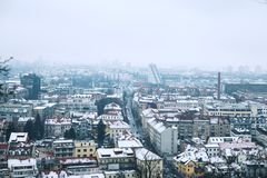 City Life of Ljubljana at winter, Slovenia, Europe. Atmospheric Real Winter Panoramic View of Ljubljana from Castle on the Snowy Red Roofs. Ljubljana, Slovenia Stock Images