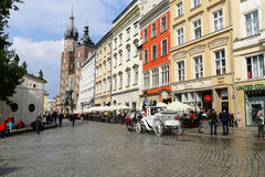 City life on the main old town square in Krakow Royalty Free Stock Images