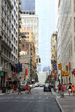 City life of New York. An ordinary street in Manhattan at noon on a weekday, in the background 1 world Trade Center, New York, United States of America royalty free stock images