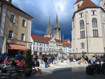 City life in Regensburg at historic town square Stock Image