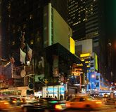 City life with Times Square at night. Vivid night scenery showing the fantastic illuminated Times Square in New York (USA) with driving cars royalty free stock image