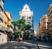 City life of Valencia Valencia, Spain. Valencia, Spain - June 3, 2017: Modern architecture in the old city center with locals and tourists. City life of Valencia Stock Image