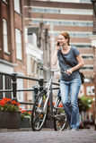 City Life - Woman with Bicycle Stock Images
