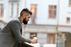 City lifestyle. Businessman well groomed appearance enjoy coffee break out of business center urban background. Relax. And recharge. Man bearded hipster drink royalty free stock photos