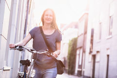 City Lifestyle - Woman with Bicycle Royalty Free Stock Images