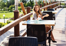 City lifestyle woman using smartphone on cafe Stock Image