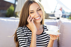 City lifestyle woman using smartphone on cafe Stock Images